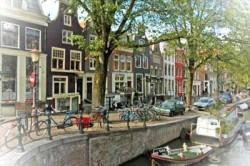 Old houses by canal in Amsterdam
